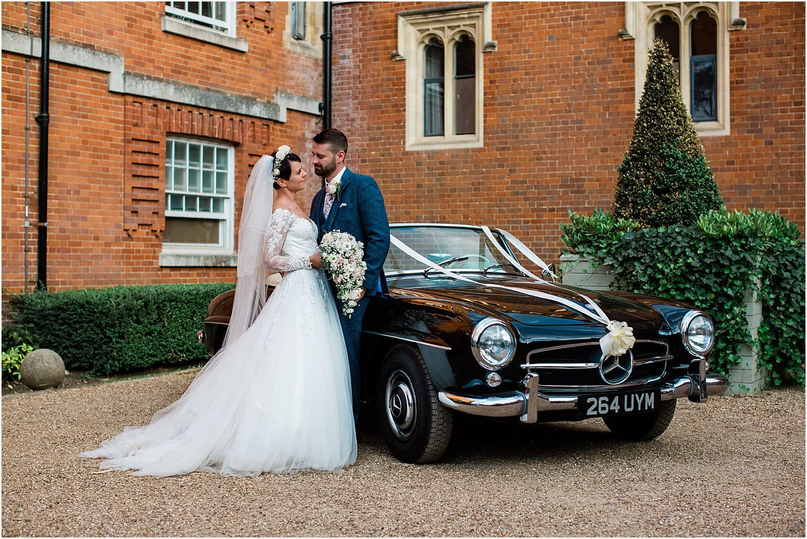 bride and groom outside wotton house on their wedding day